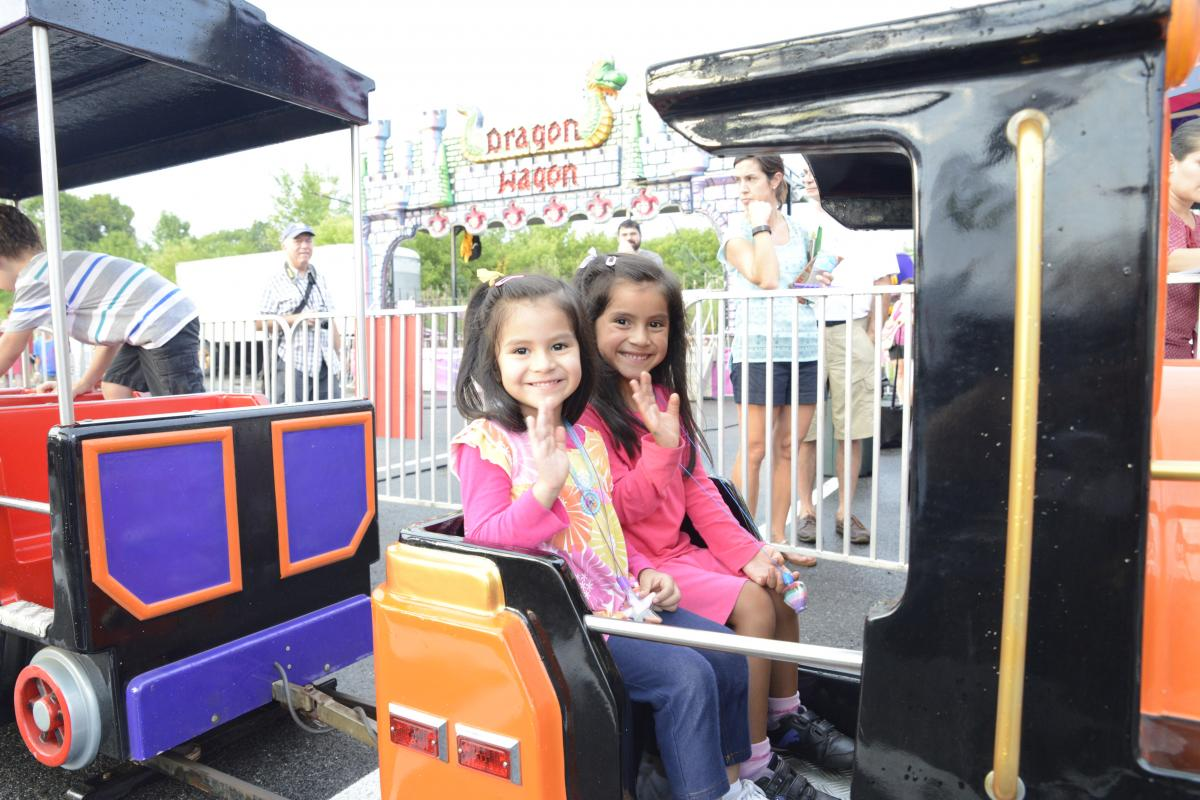 Children enjoying the rides at the 54th Annual Summer Festival