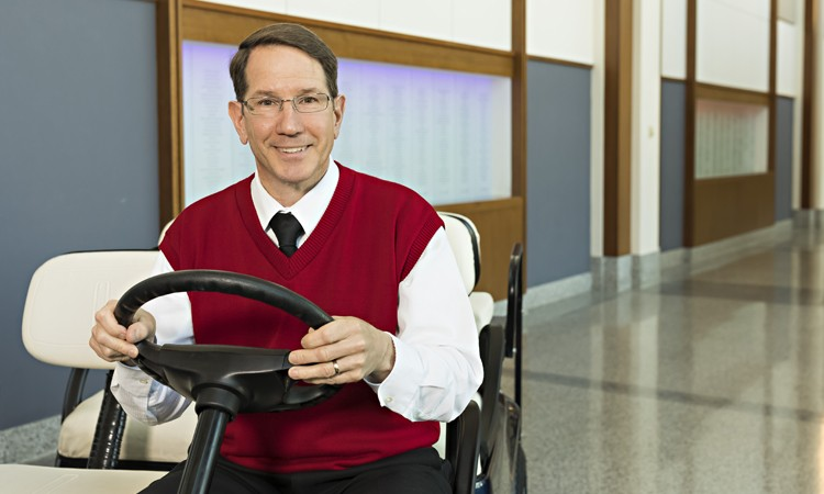Guest services ambassadors like Rand Kreider drive visitors to locations inside Lehigh Valley Hospital–Cedar Crest