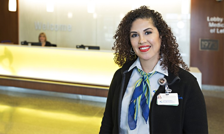 You will receive a friendly welcome and assistance from a guest services representative like Luz Diaz at the front entrance welcome desk, located on the first floor of Lehigh Valley Hospital–Cedar Crest