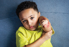 Boy with hurt elbow