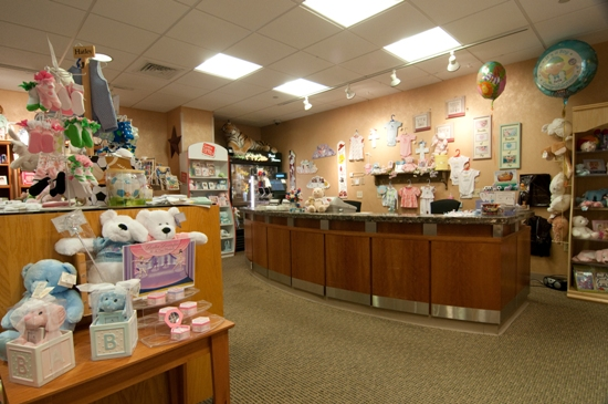 Fresh flowers, baby clothes, hats and blankets, and birth announcements are available for purchase in this gift shop.